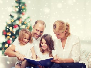 girls reading book over living room and christmas tree background